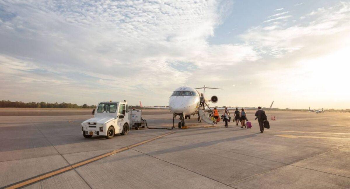 Airport runway, people boarding on plane