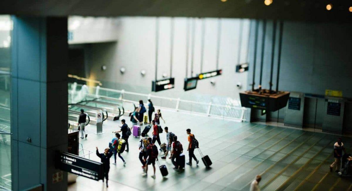 people rushing through airport